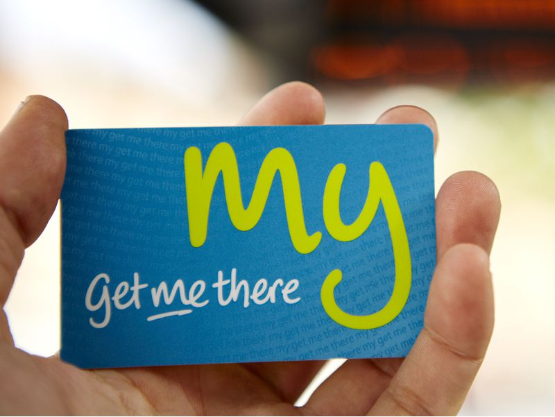 Hand holding a Get me there RFID smart card from Made by Oomph