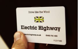 Hand holding Ecotricity printed RFID smart card made by oomph